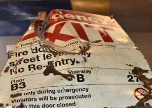 """""""9/11 Attack After-Effects, ruined Twin Towers emergency exit doorway."""" Photographed by divemasterking200, Flickr."""